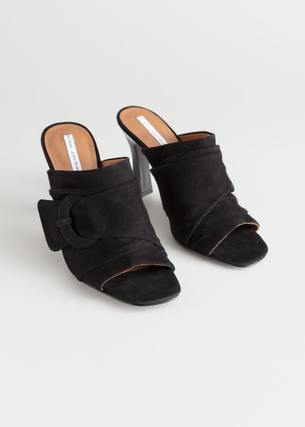 Back image of Stories square buckle open toe mules in black