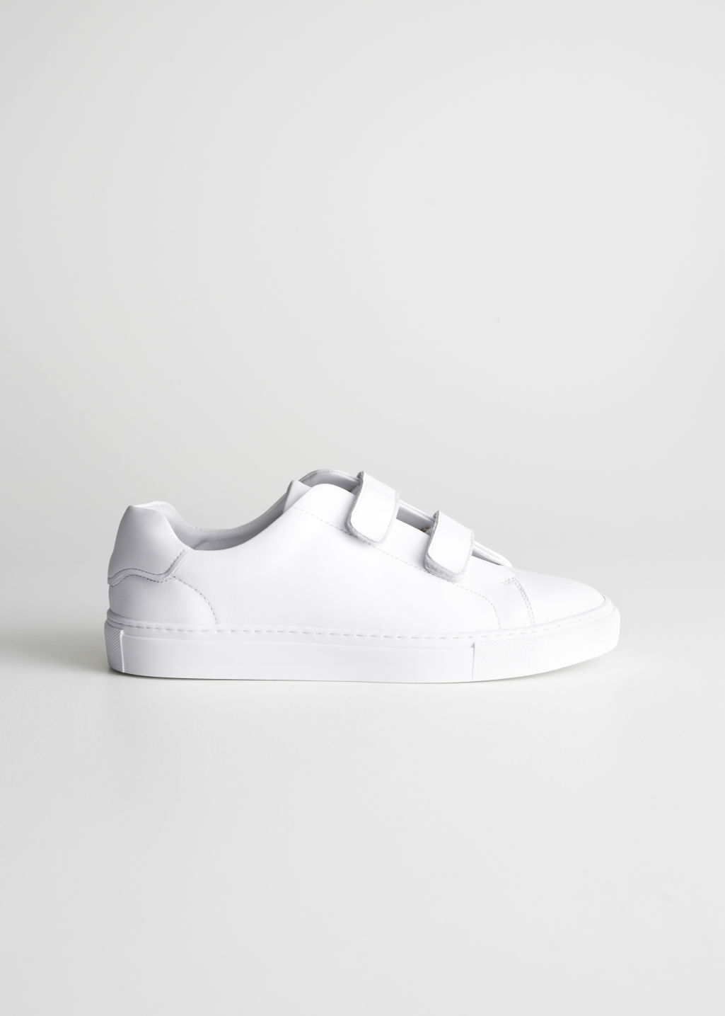 Front image of Stories duo scratch strap sneakers in white