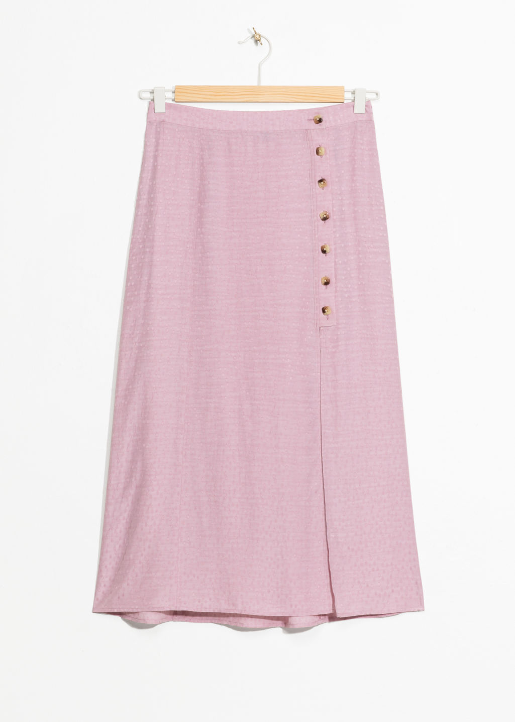 Front image of Stories asymmetrical button midi skirt in pink