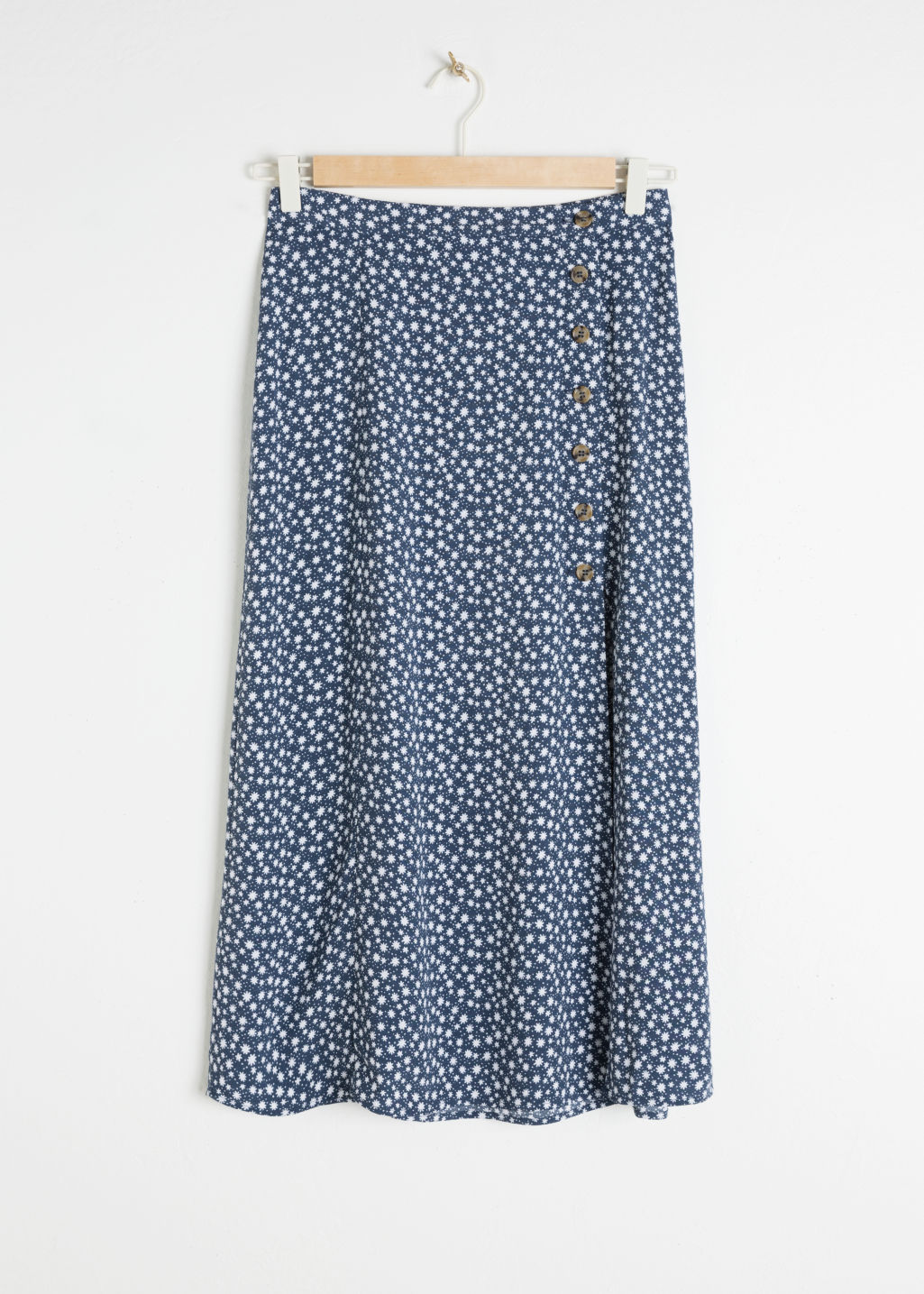 Front image of Stories asymmetrical button midi skirt in blue