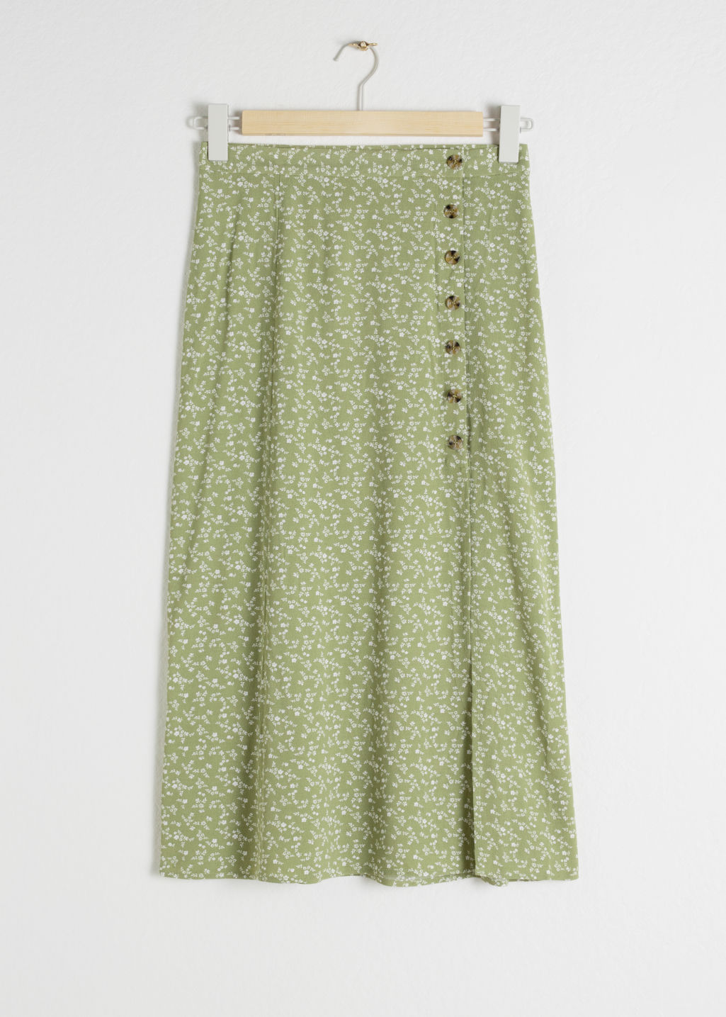 Front image of Stories asymmetrical button midi skirt in green
