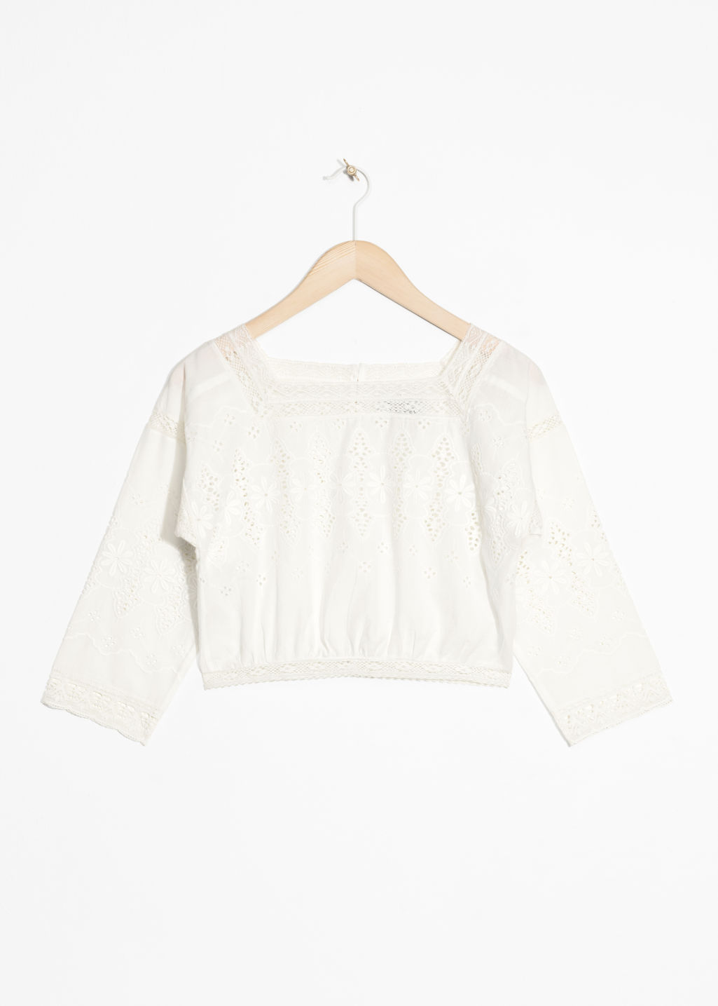 Front image of Stories cropped eyelet lace blouse in white