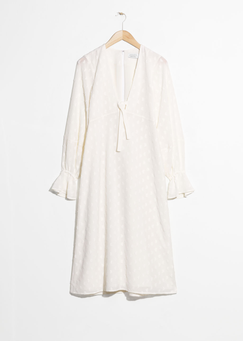 Front image of Stories plunging jacquard midi dress in white
