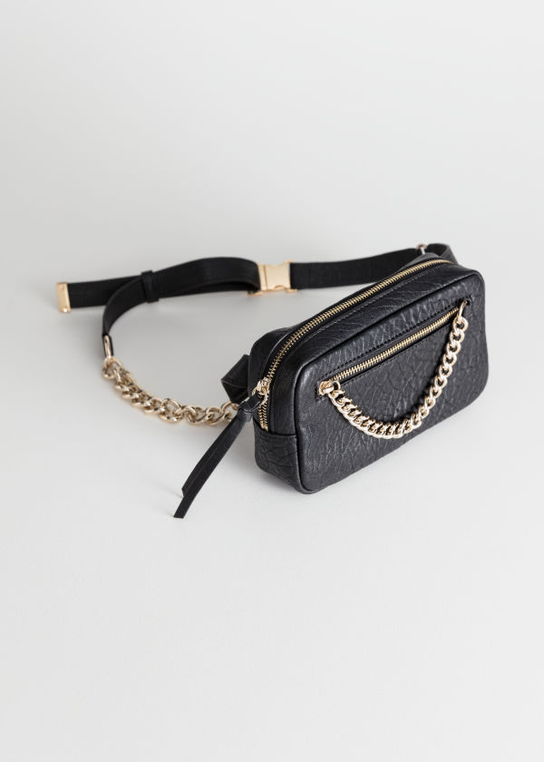 Front image of Stories grainy leather chain beltbag in black