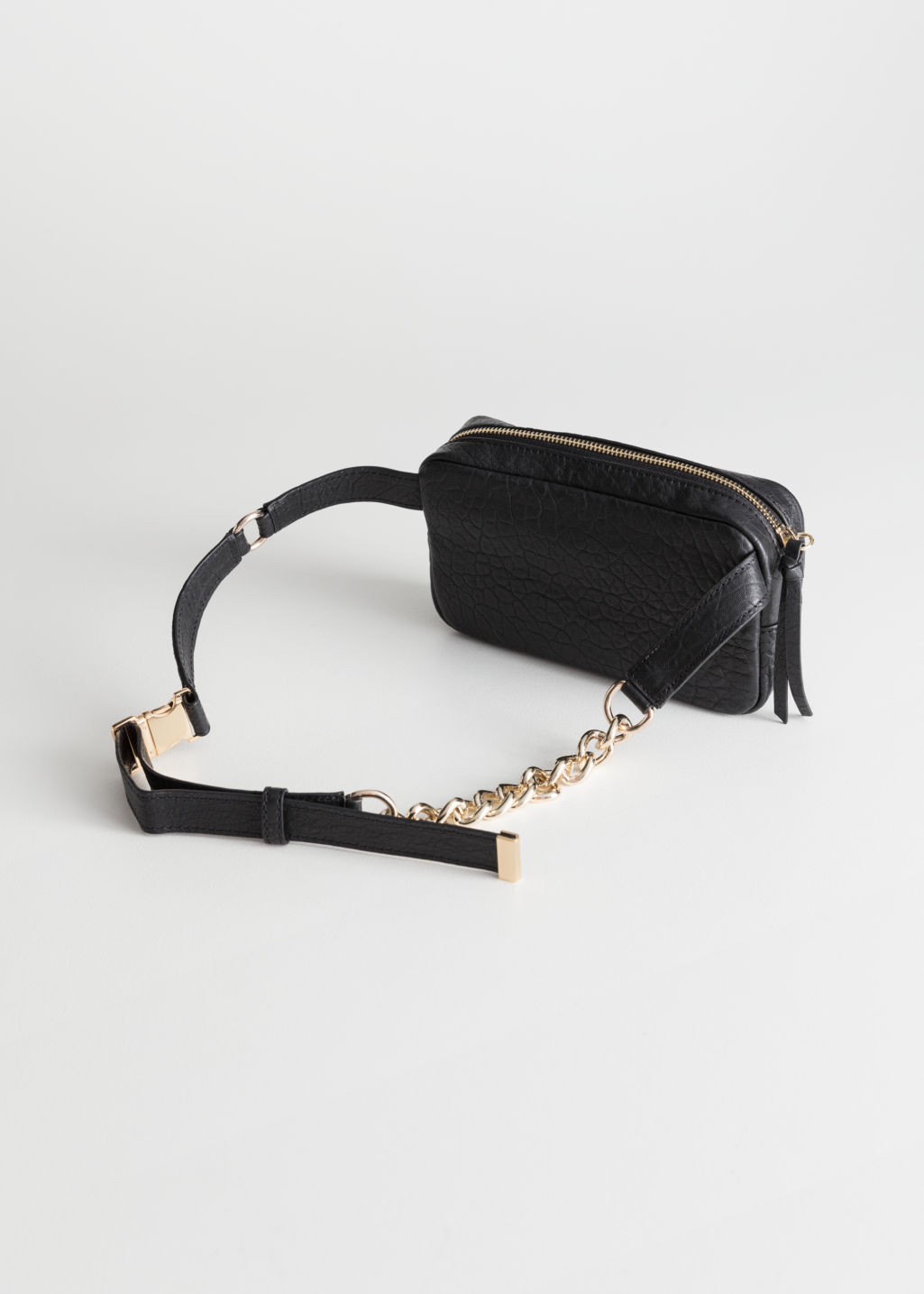 Back image of Stories grainy leather chain beltbag in black