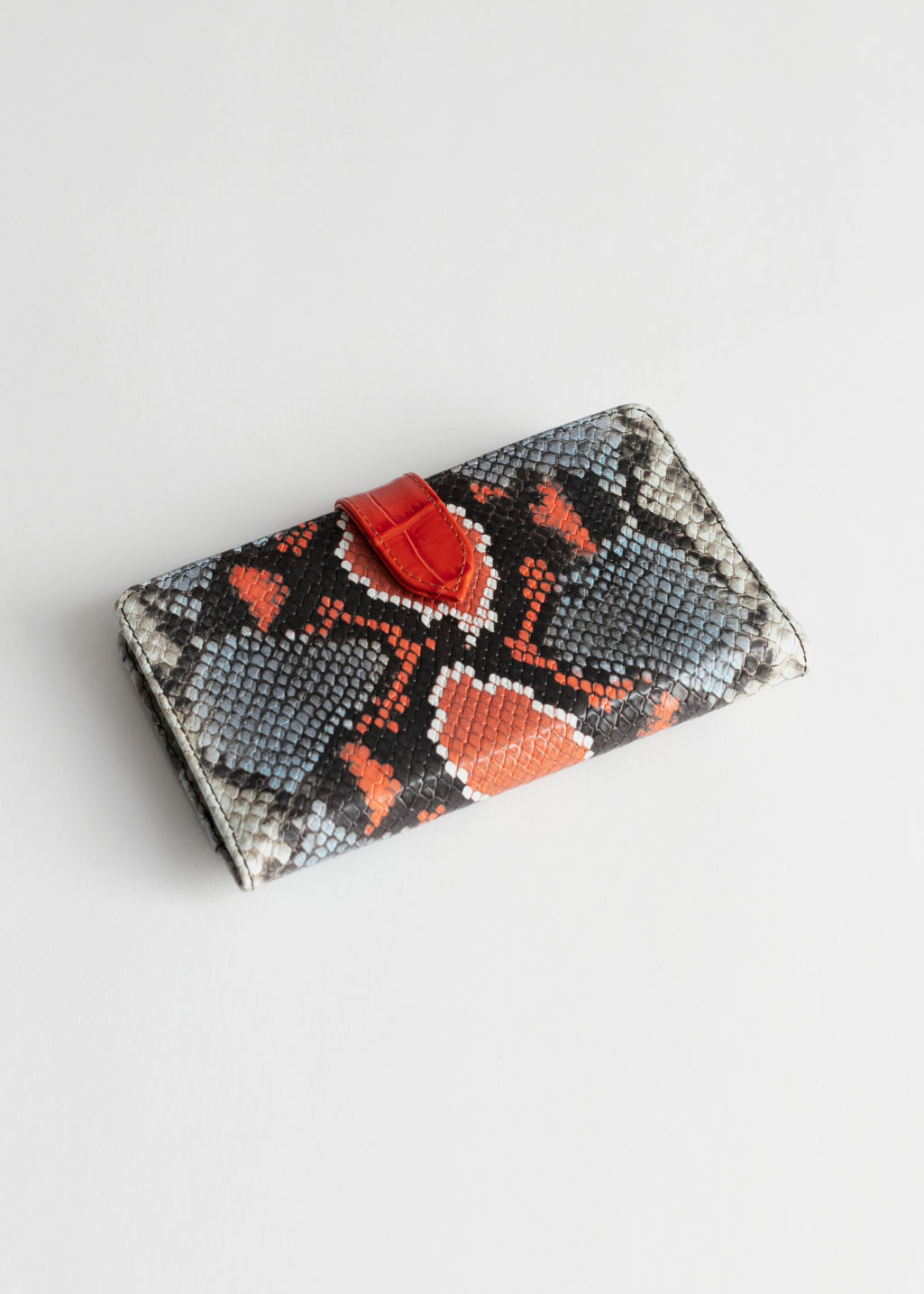 Front image of Stories snake print leather wallet in orange