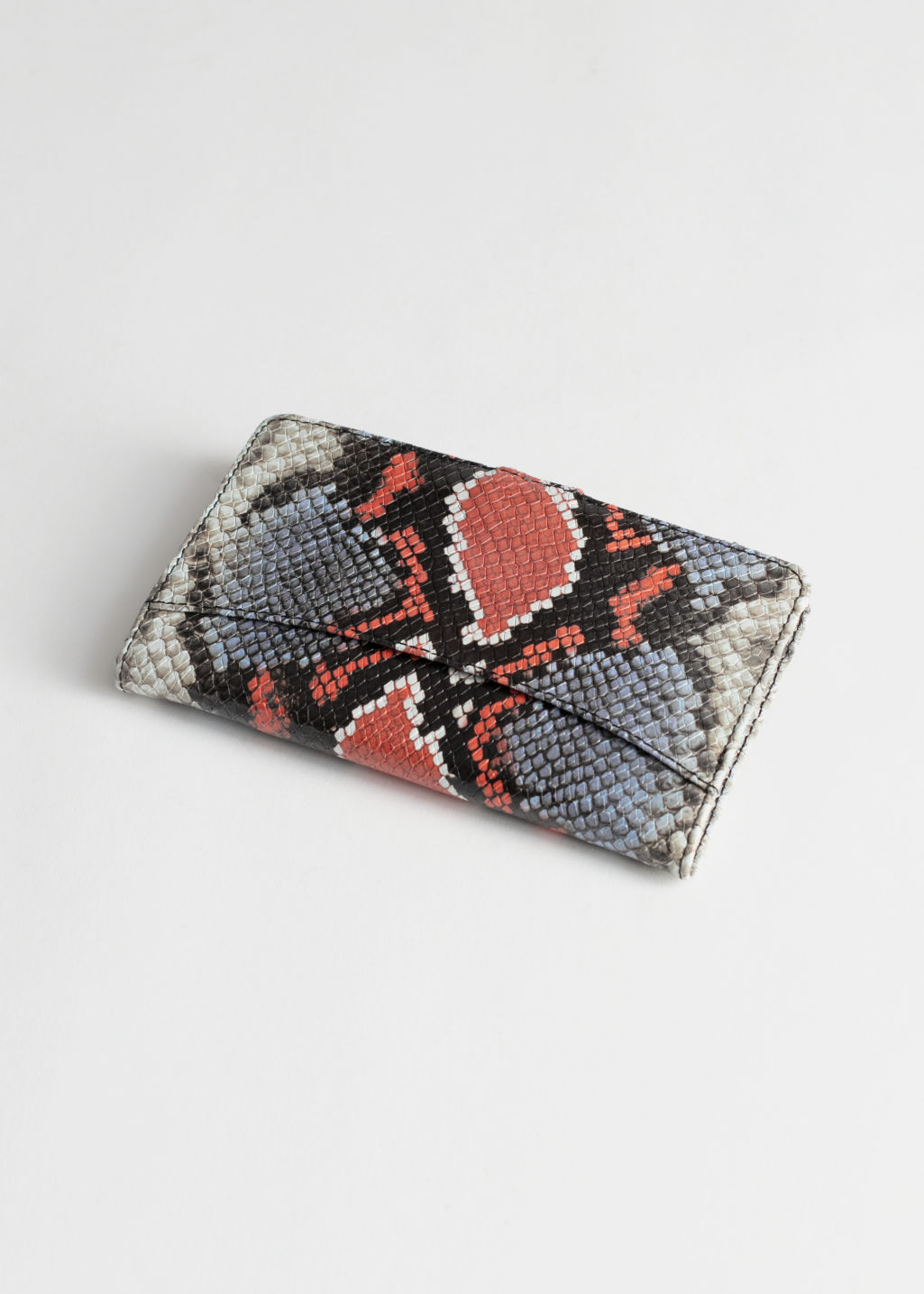 Back image of Stories snake print leather wallet in orange