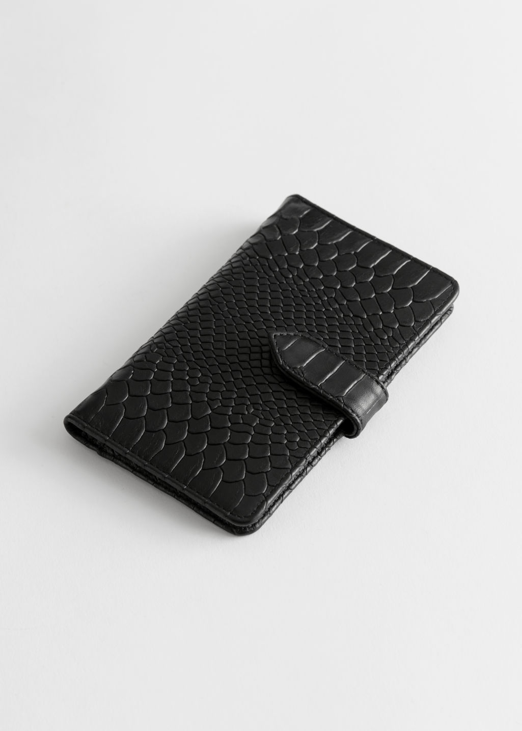Front image of Stories snake print leather wallet in black