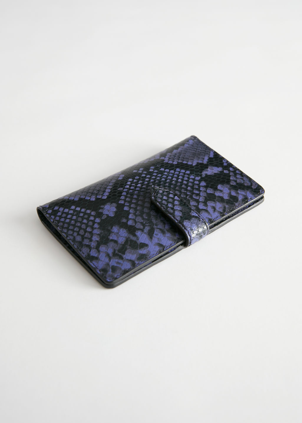 Front image of Stories snake embossed leather wallet in purple
