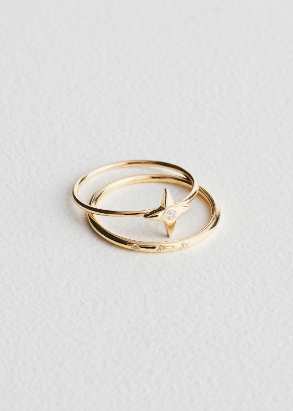 Front image of Stories four point star ring set in gold