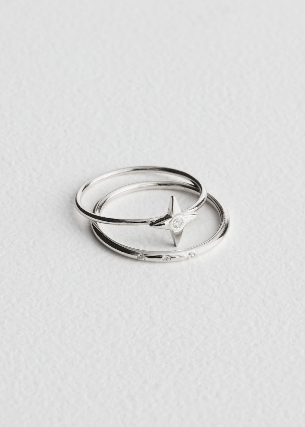 Front image of Stories four point star ring set in silver