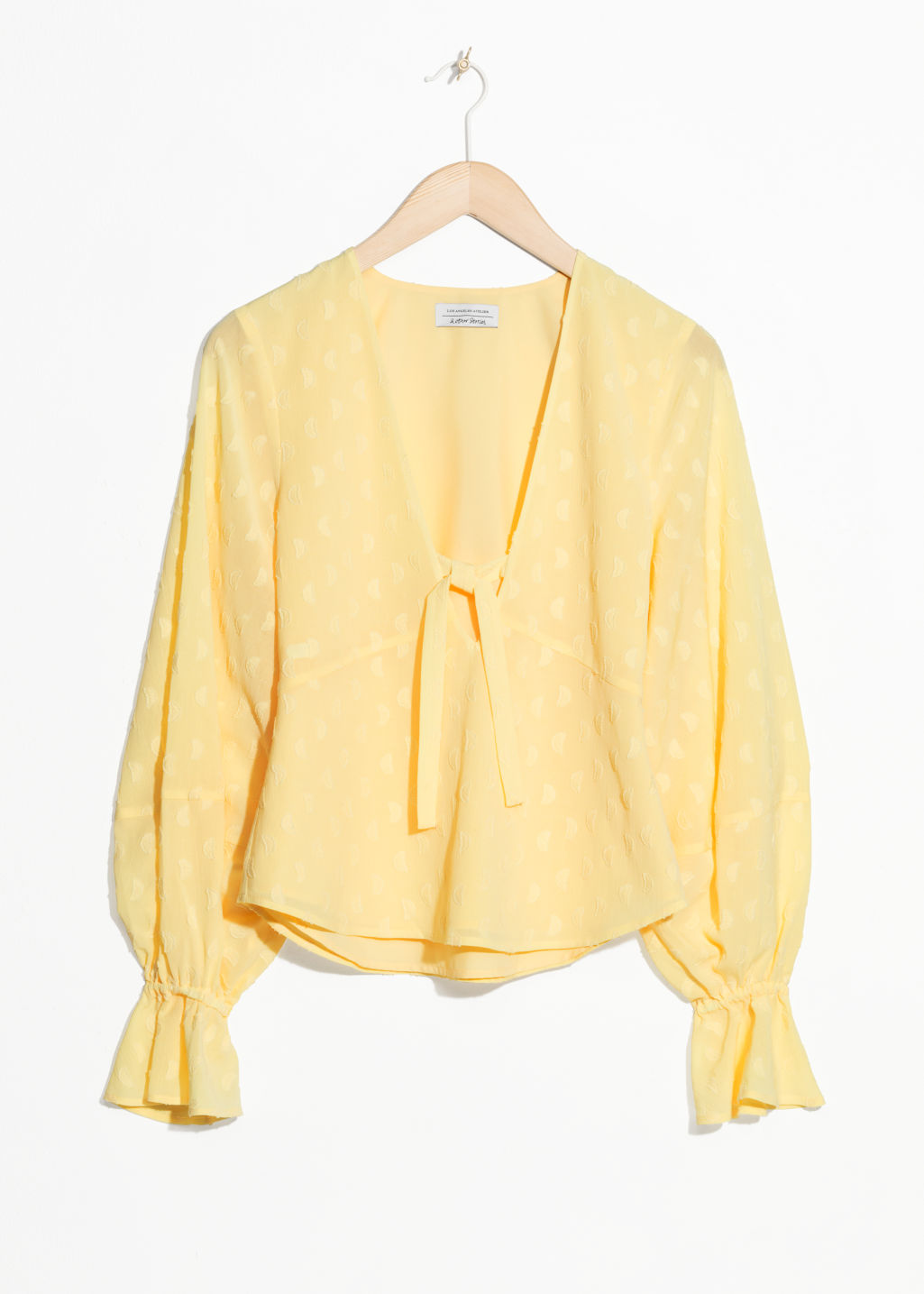 Front image of Stories plunging jacquard blouse  in yellow