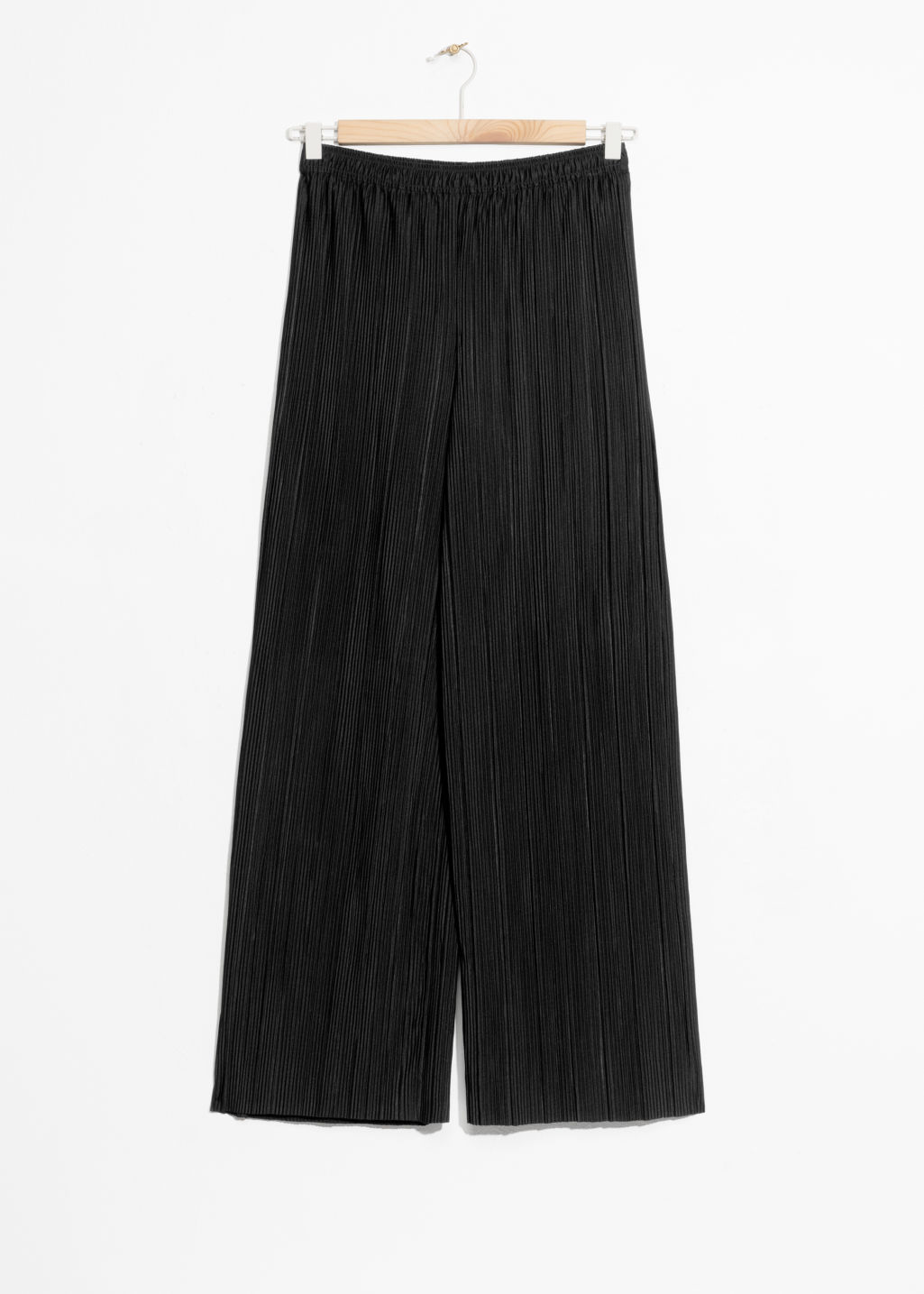 Front image of Stories high waisted pleated trousers in black