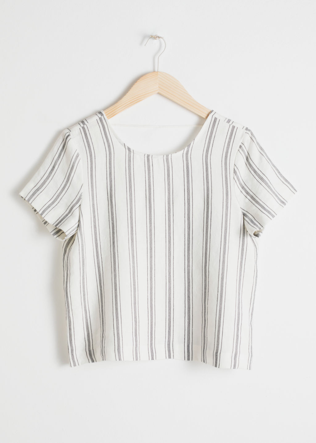 Front image of Stories striped linen top in white