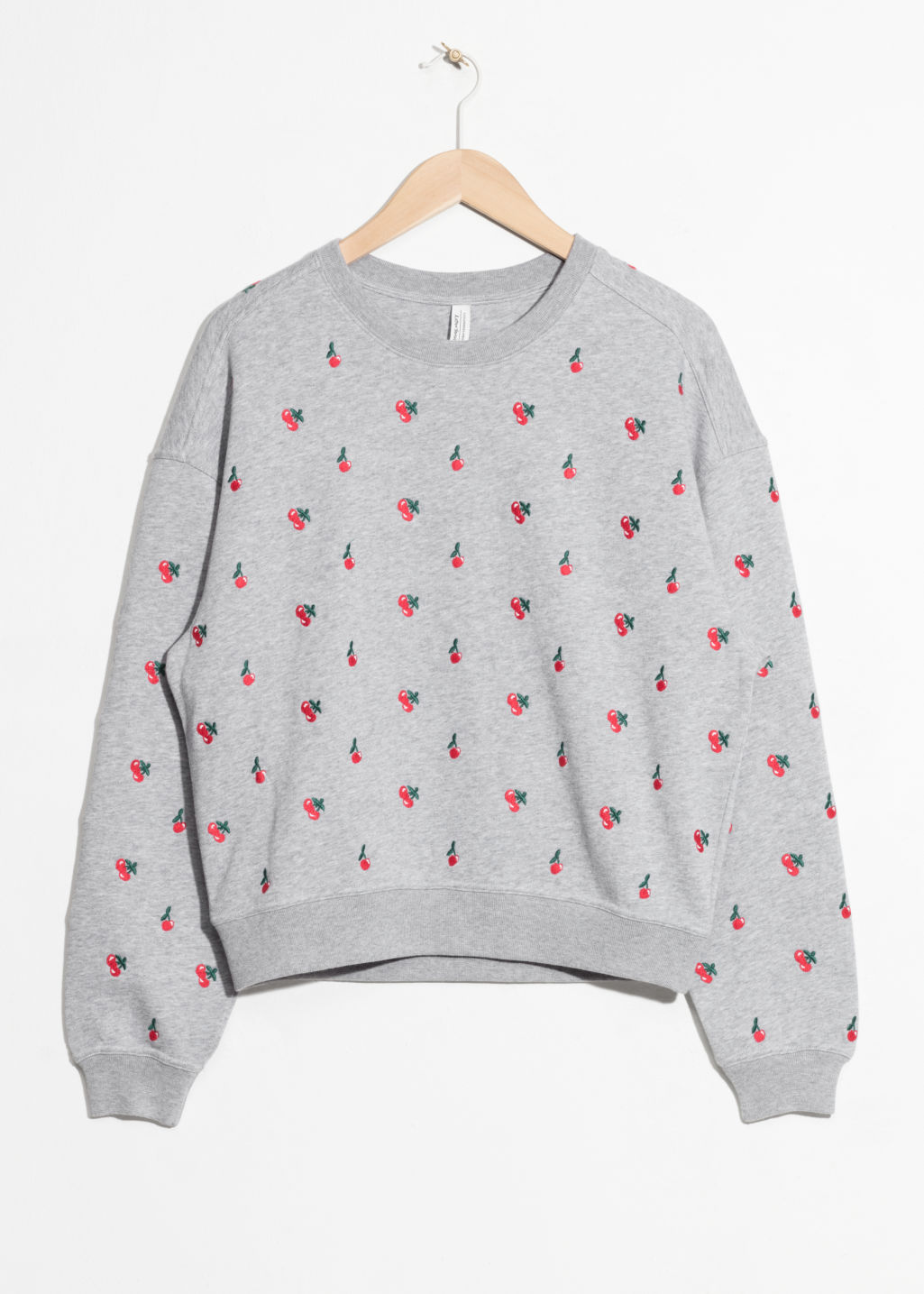 Front image of Stories embroidered cherry pullover in grey