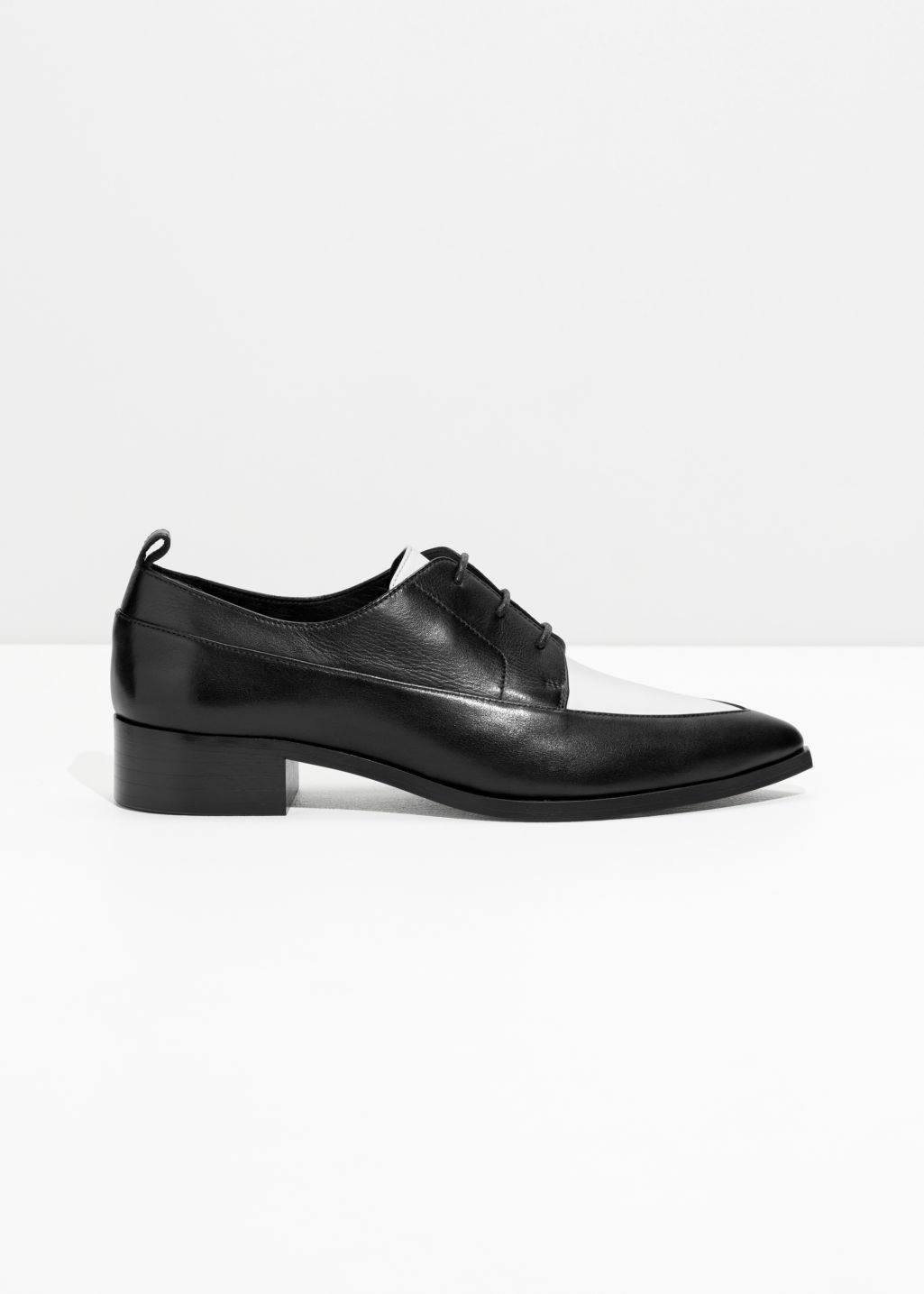 Front image of Stories saddle oxfords in black