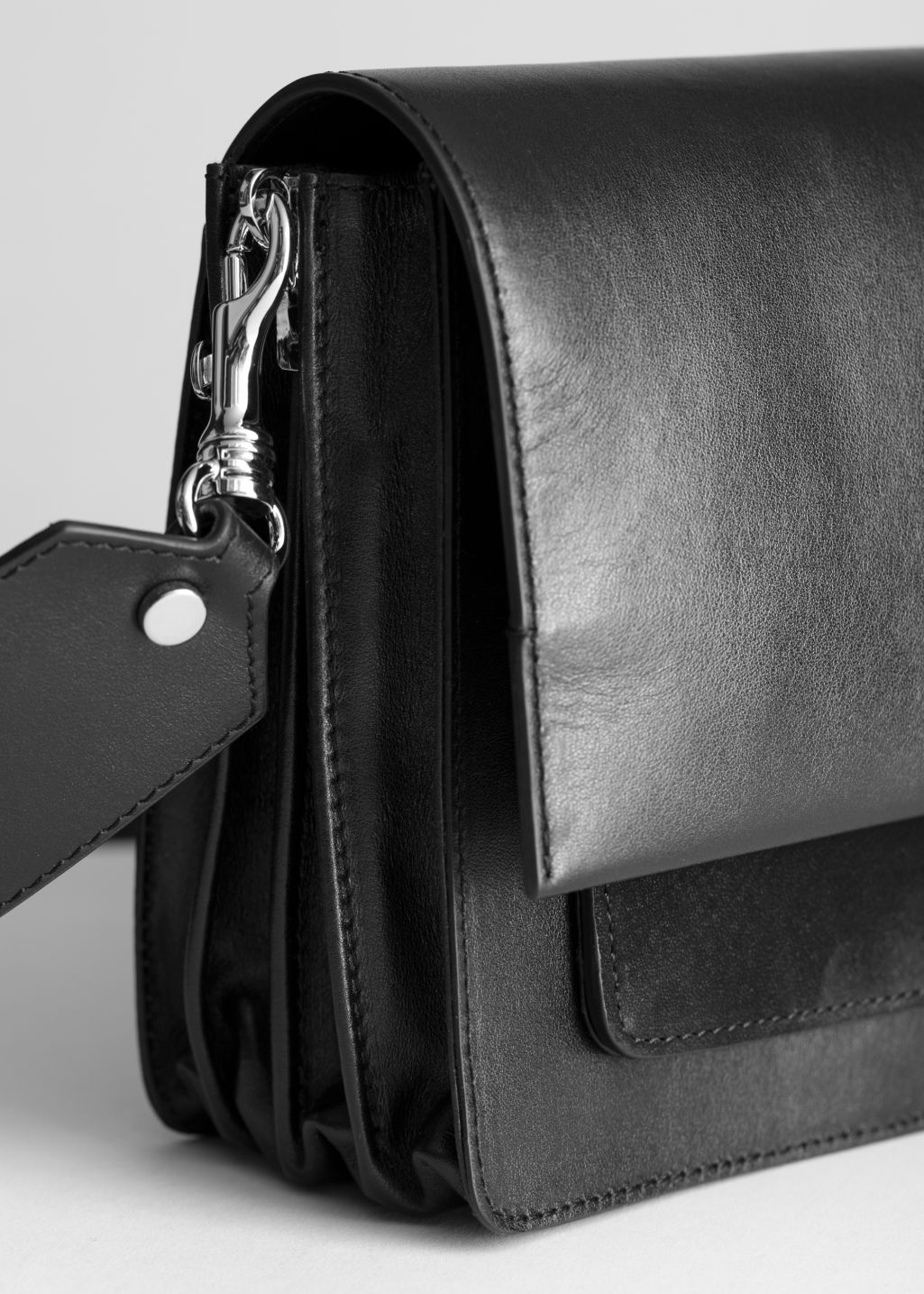 Back image of Stories short leather crossbody bag in black
