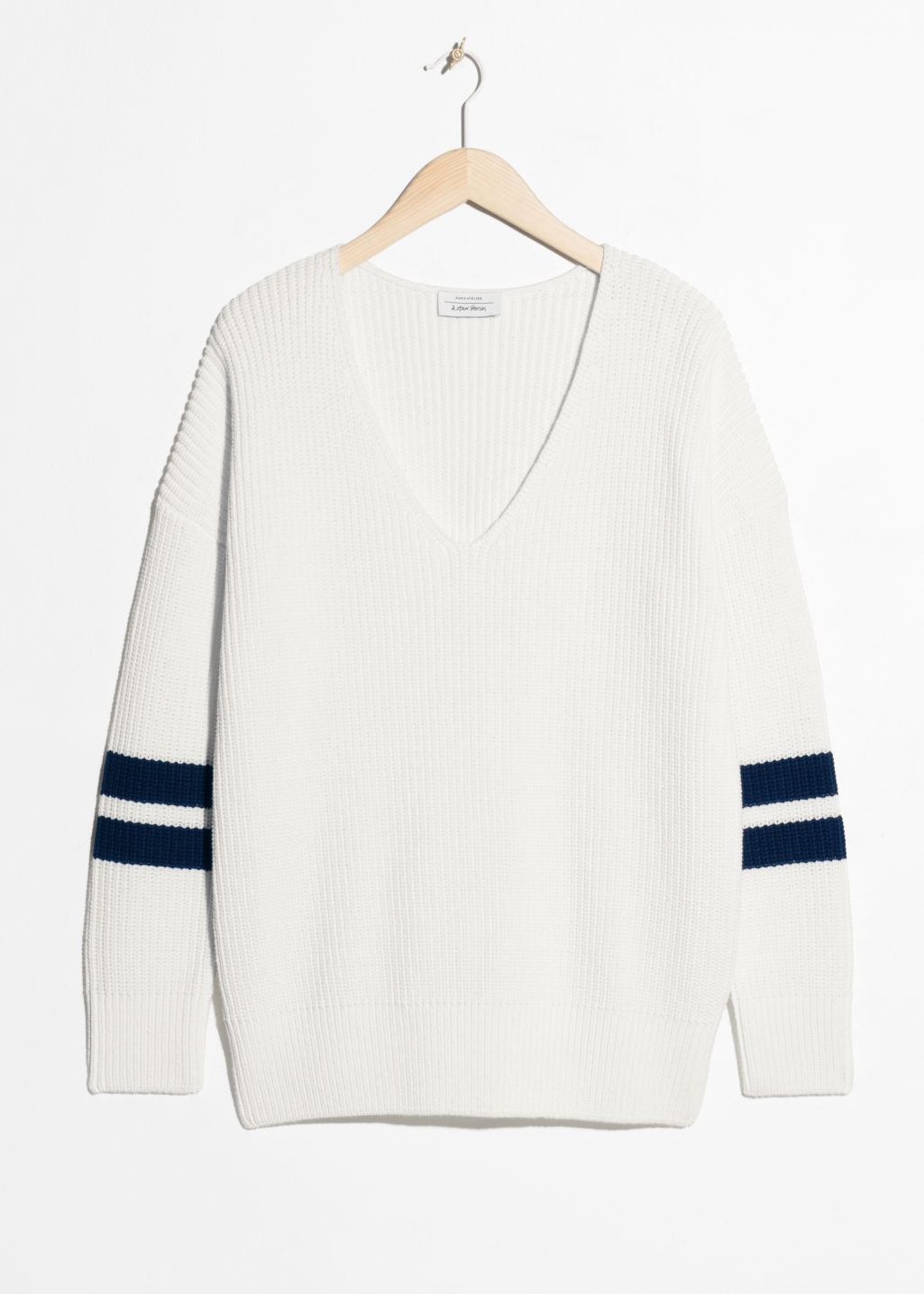 Front image of Stories boyfriend fit varsity sweater  in white