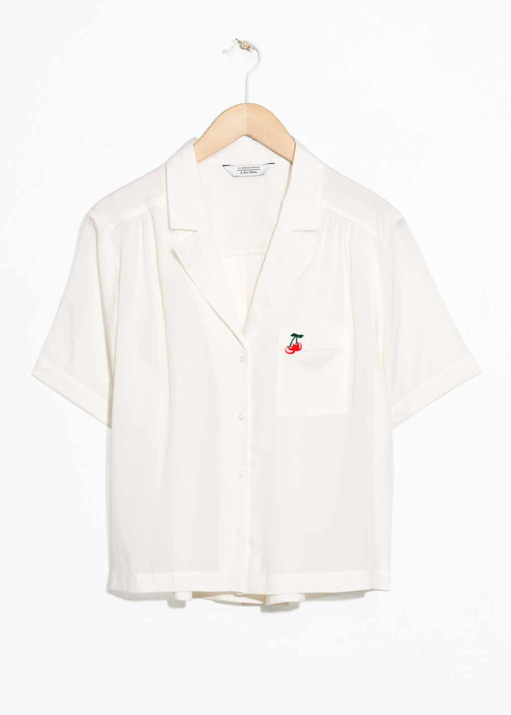Front image of Stories cherry patch button down  in white