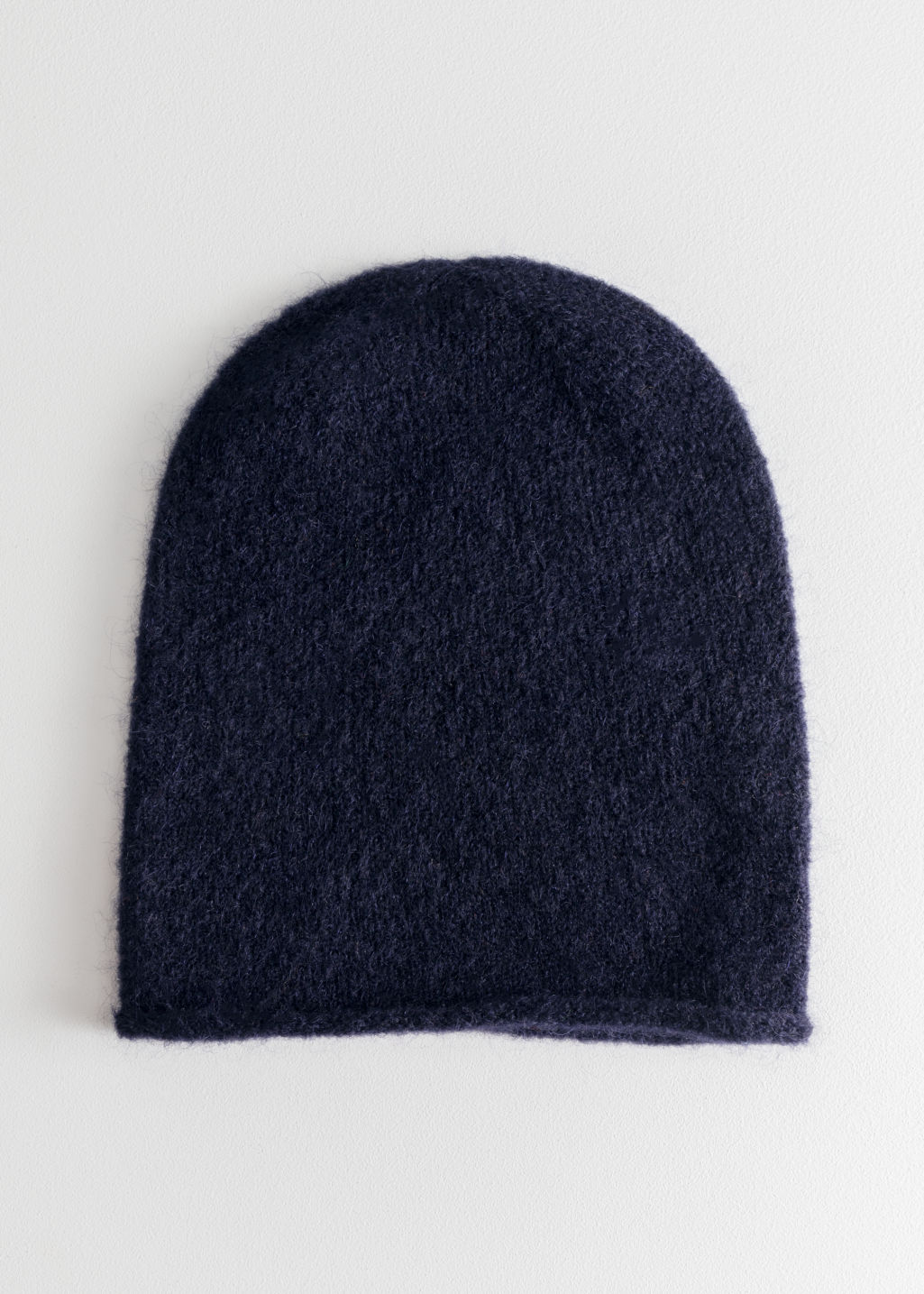 Front image of Stories slouchy wool blend beanie in blue