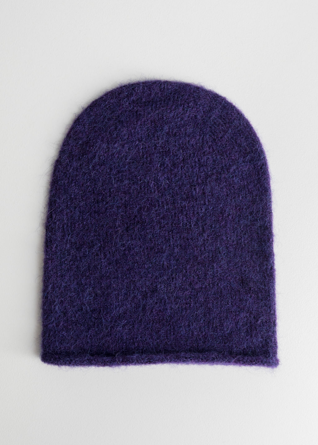 Front image of Stories slouchy wool blend beanie in purple