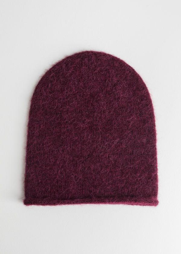 Front image of Stories slouchy wool blend beanie in red