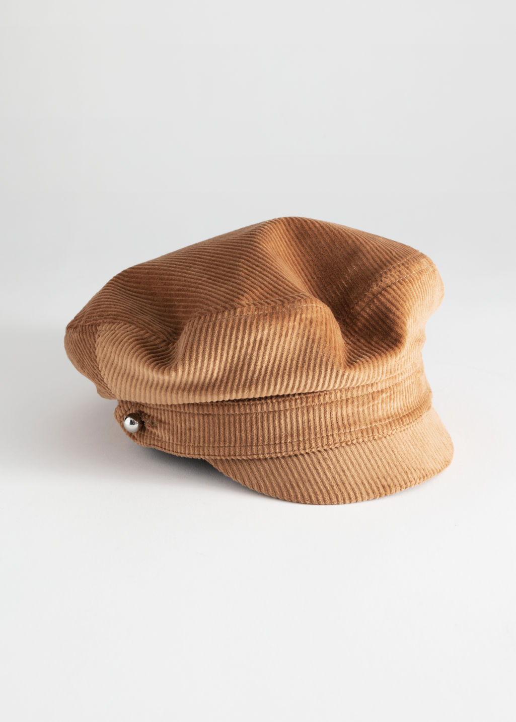 Front image of Stories corduroy baker boy cap in beige