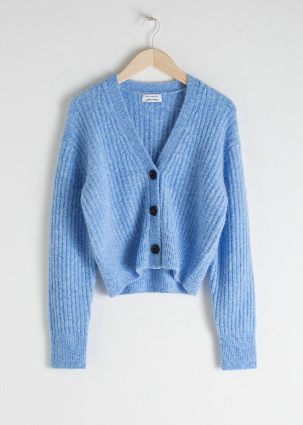 Front image of Stories wool blend cardigan in blue