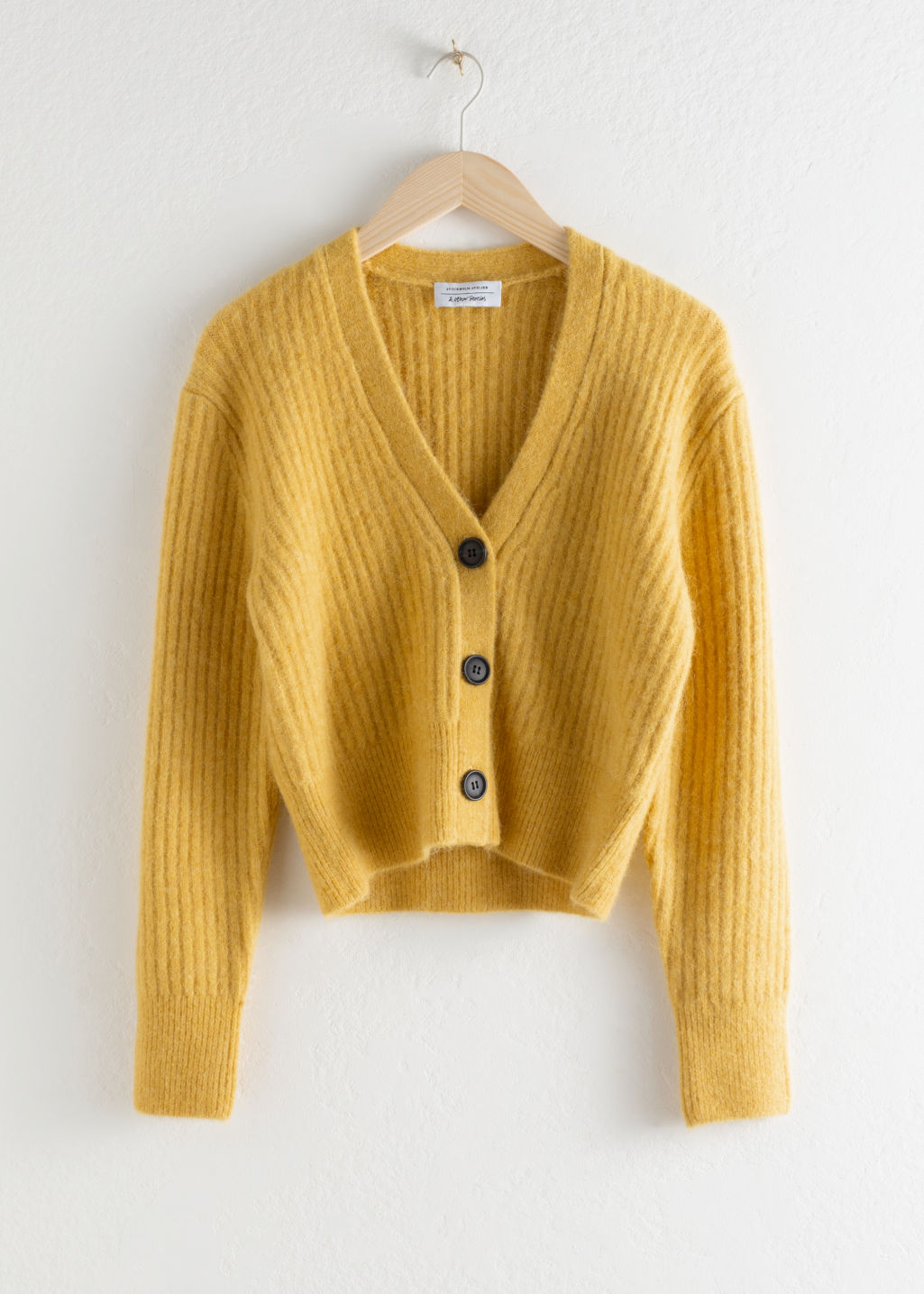 Front image of Stories wool blend cardigan in yellow