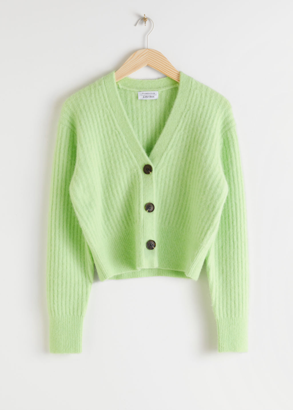 Front image of Stories wool blend cardigan in green