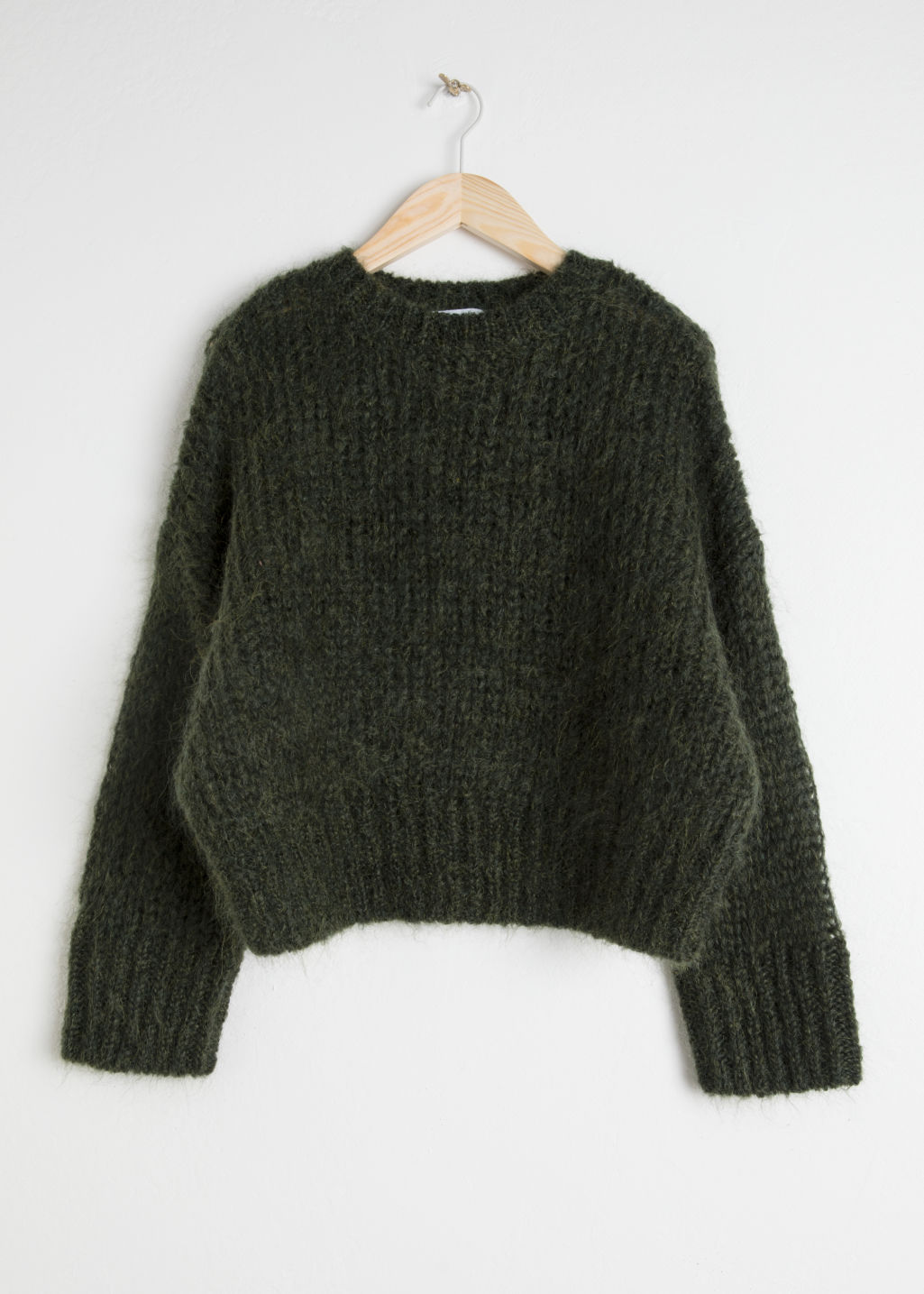 Front image of Stories wool blend chunky knit sweater in green