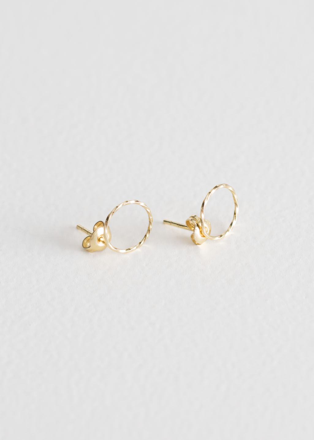Front image of Stories twisted circle earrings in gold