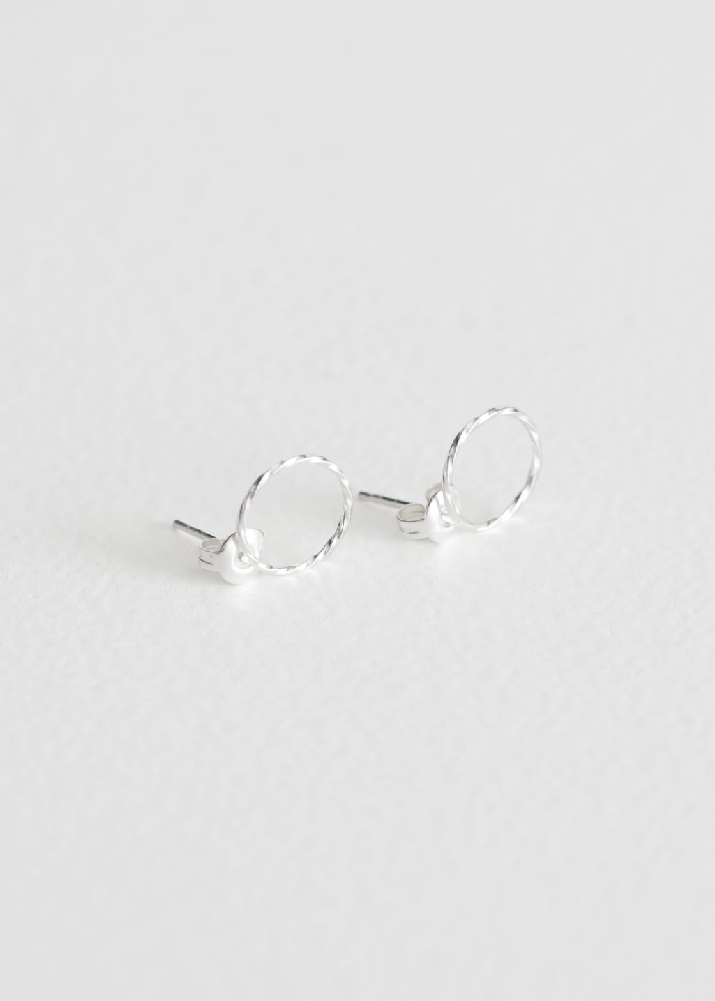 Front image of Stories twisted circle earrings in silver