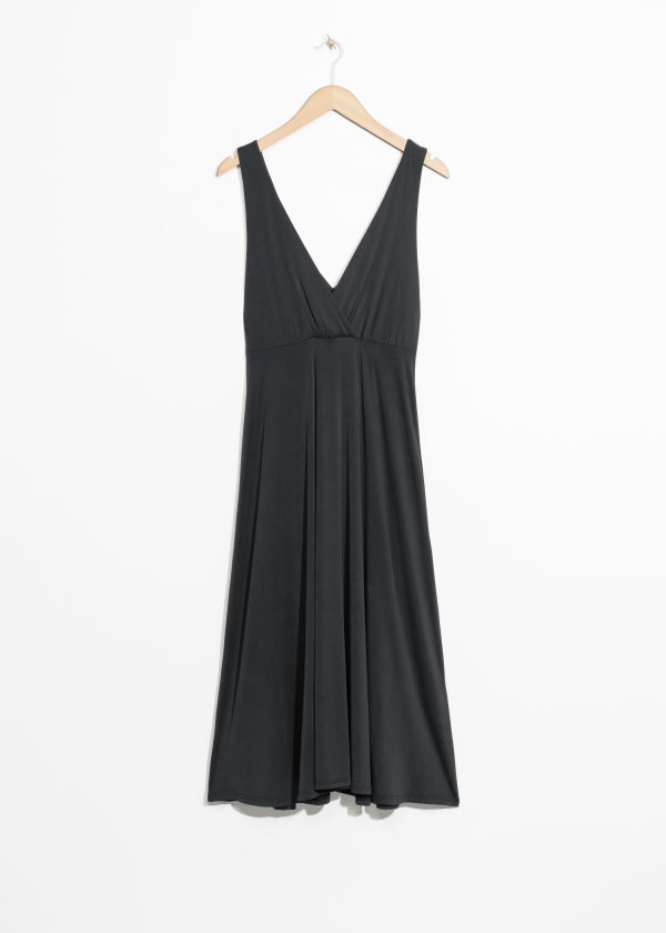 Front image of Stories plunging midi dress in black