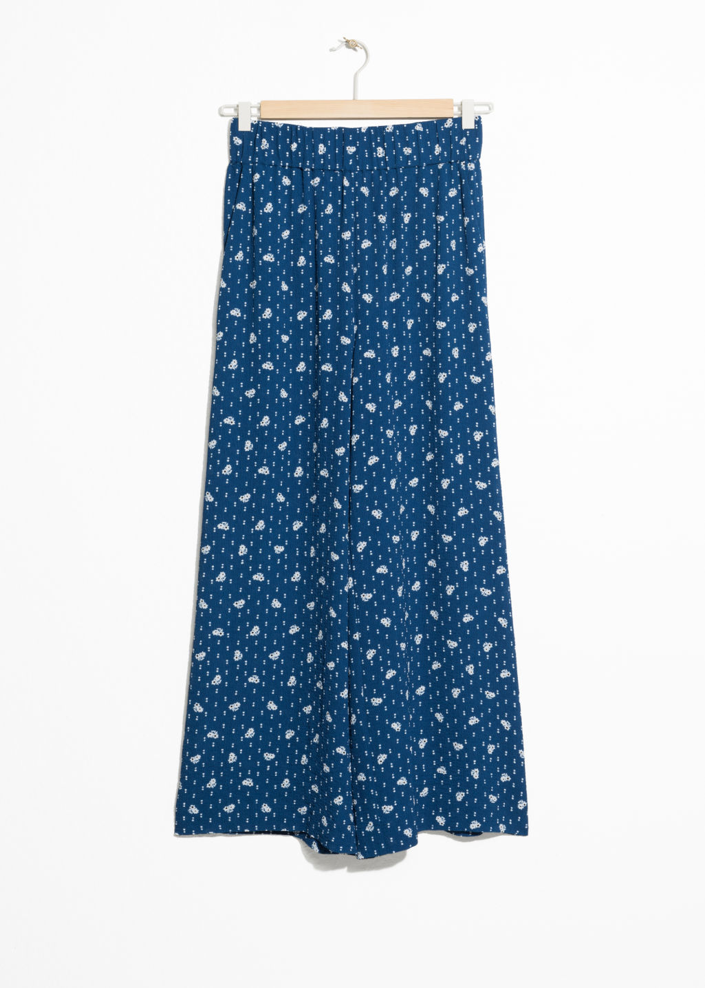 Front image of Stories flower print wide trousers in blue