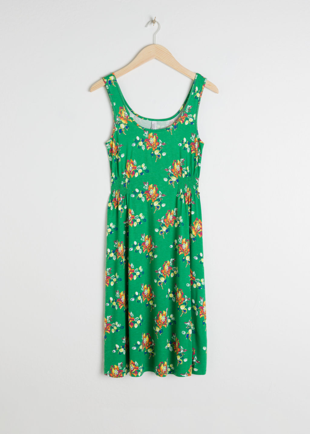 Front image of Stories printed summer dress in green