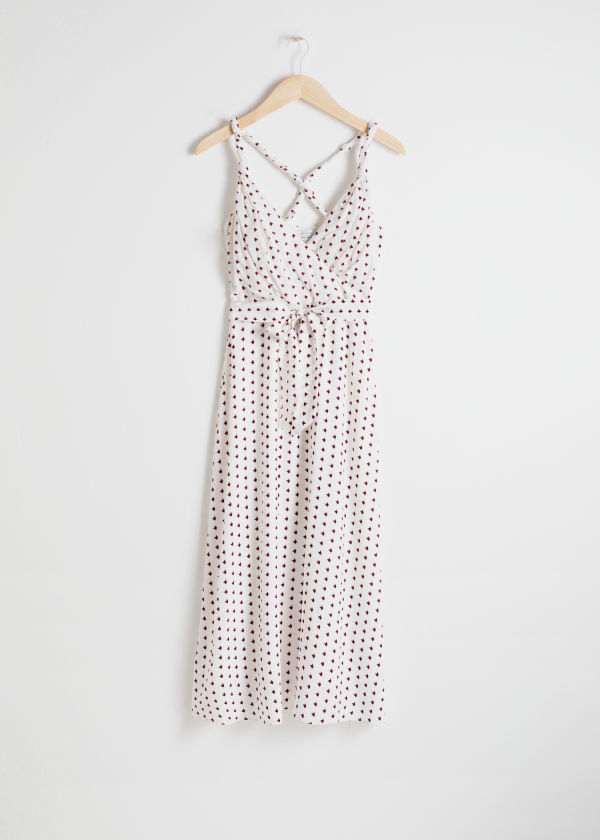 Front image of Stories printed wrap dress in white