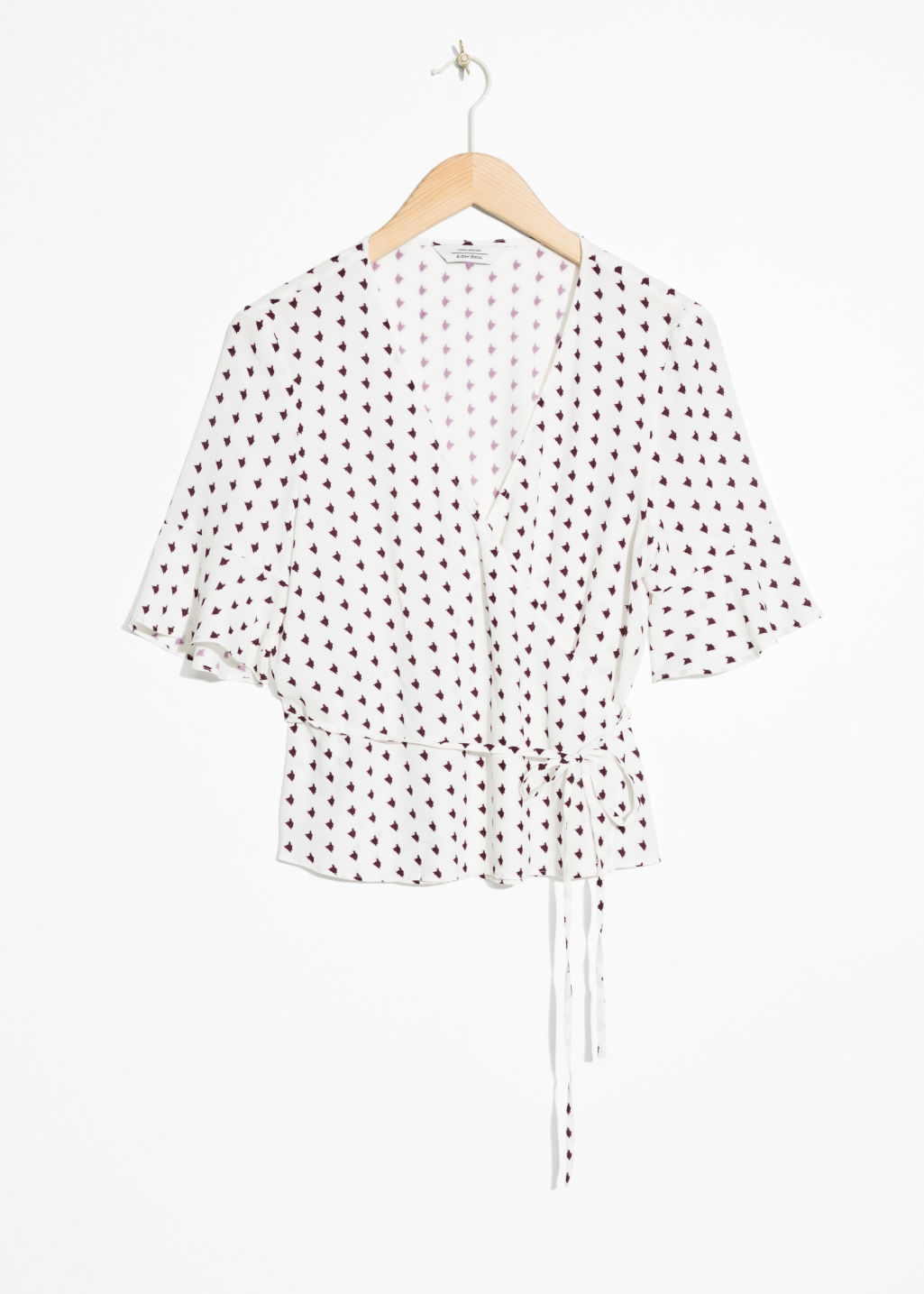 Front image of Stories abstract spotted wrap blouse  in white