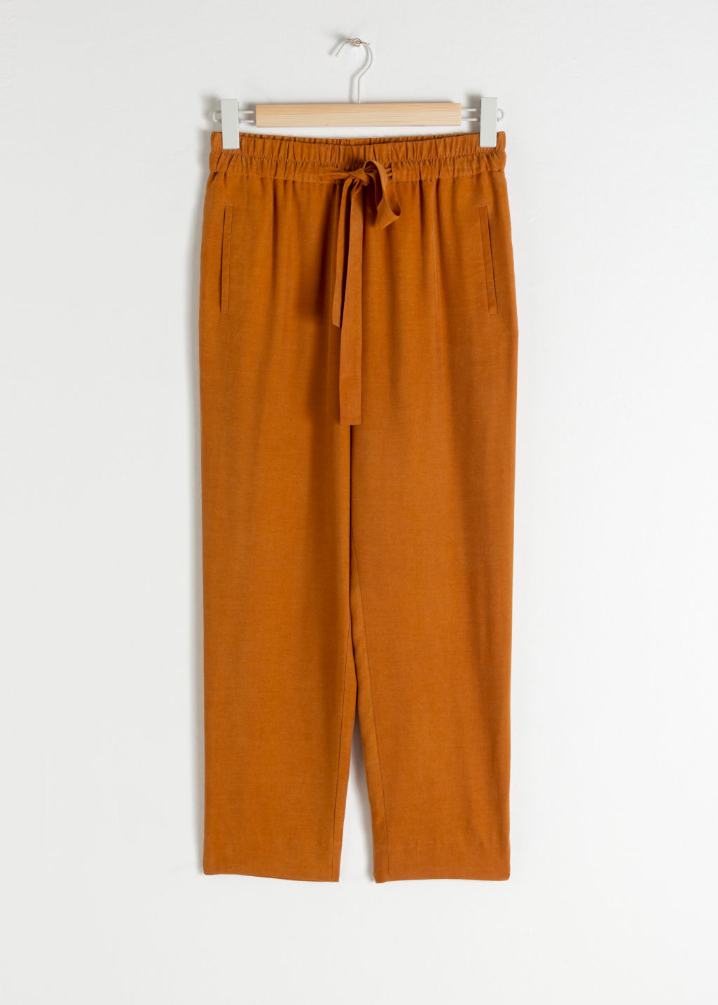 Front image of Stories cupro blend jogger trousers in orange