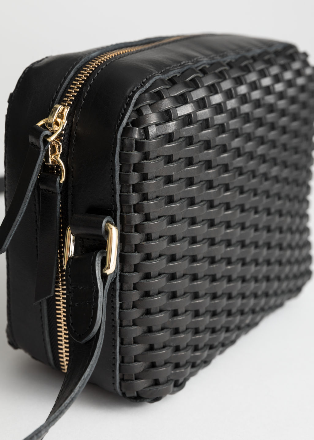 Back image of Stories basket weave crossbody bag in black
