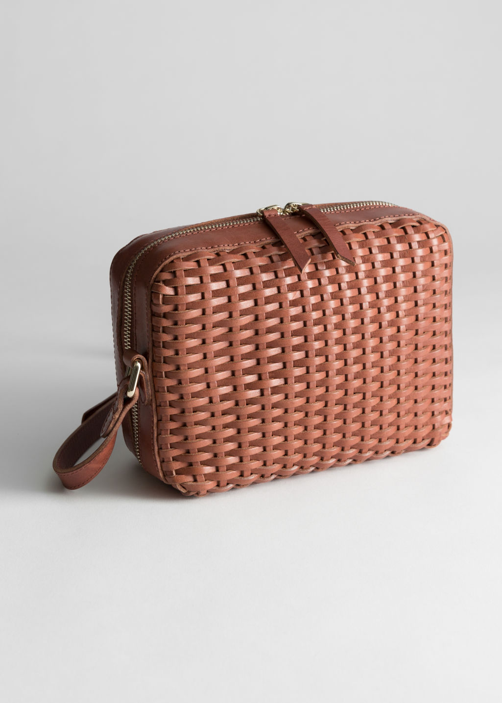 Front image of Stories basket weave crossbody bag in brown