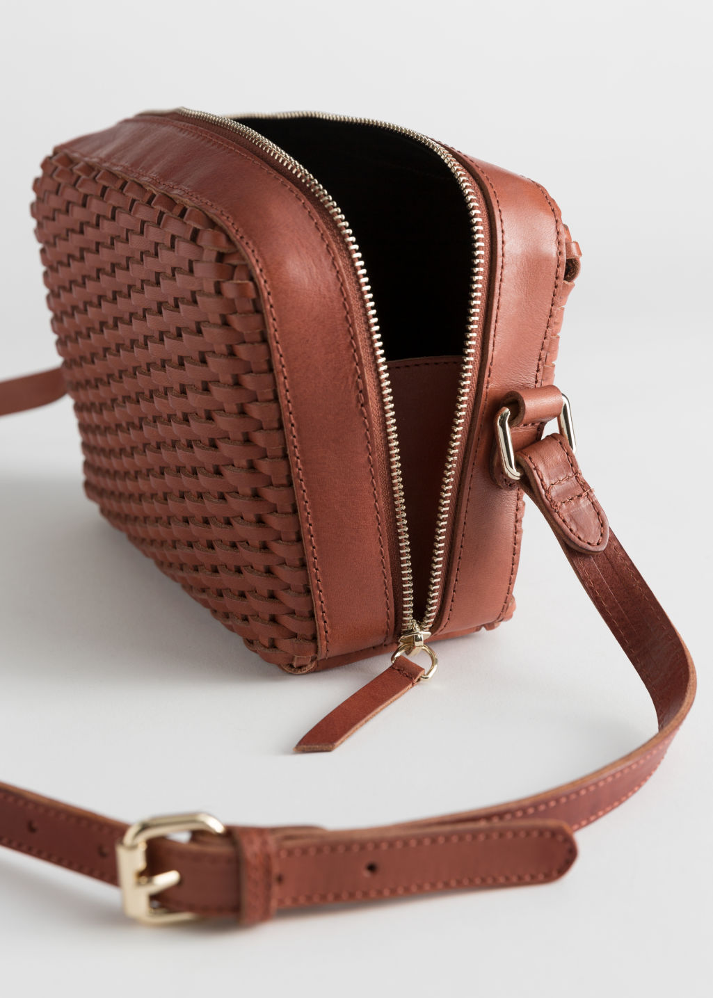 Back image of Stories basket weave crossbody bag in brown
