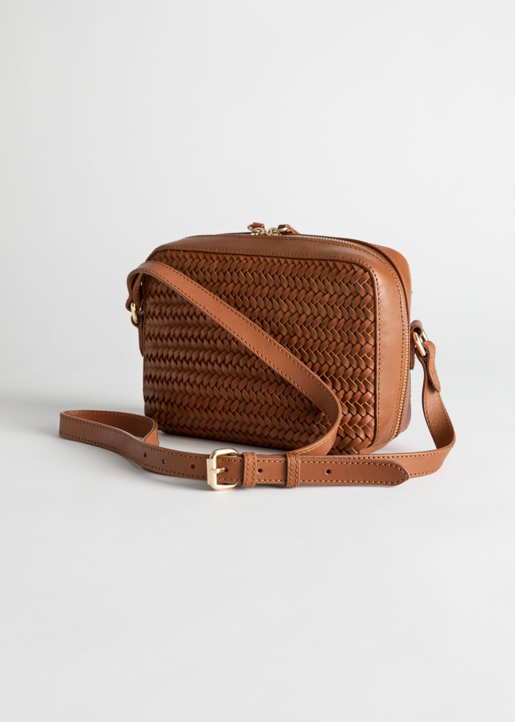 Front image of Stories basket weave crossbody bag in beige