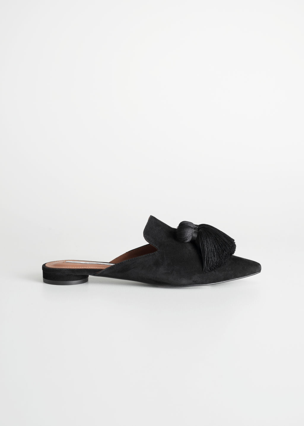 Front image of Stories pointed tassel slip ons in black