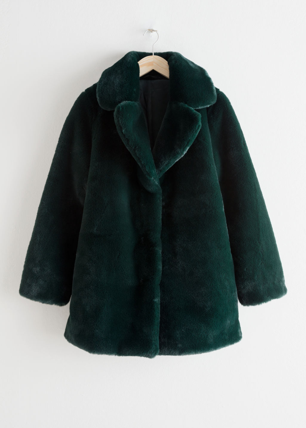 Front image of Stories short faux fur coat in turquoise
