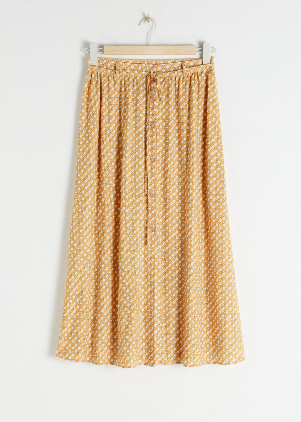 Front image of Stories tropical print midi skirt in yellow
