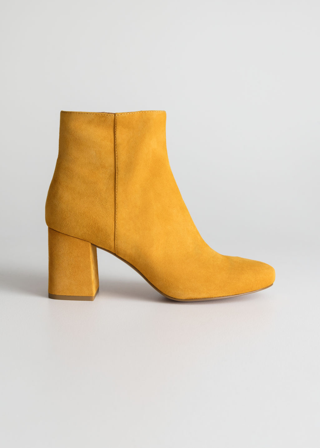 Front image of Stories suede ankle boots in yellow