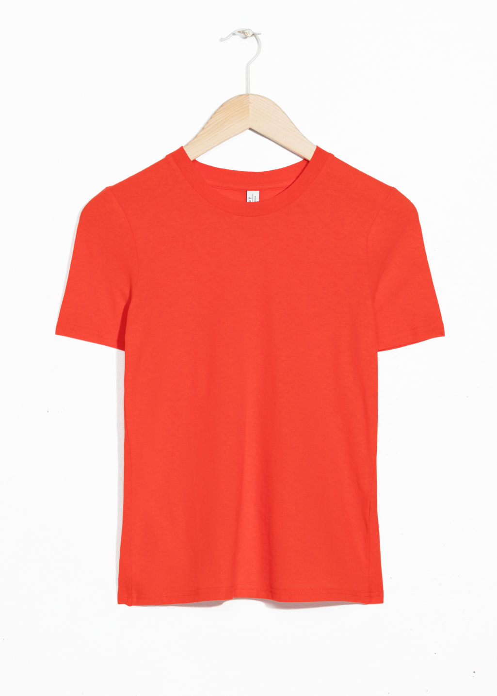 Front image of Stories fitted crewneck tee in orange
