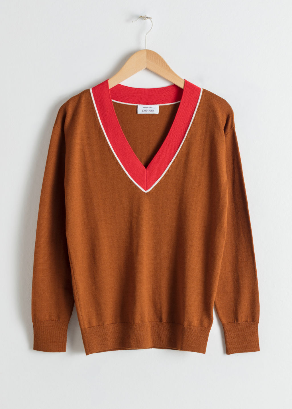 Front image of Stories wool v-neck varsity sweater in orange