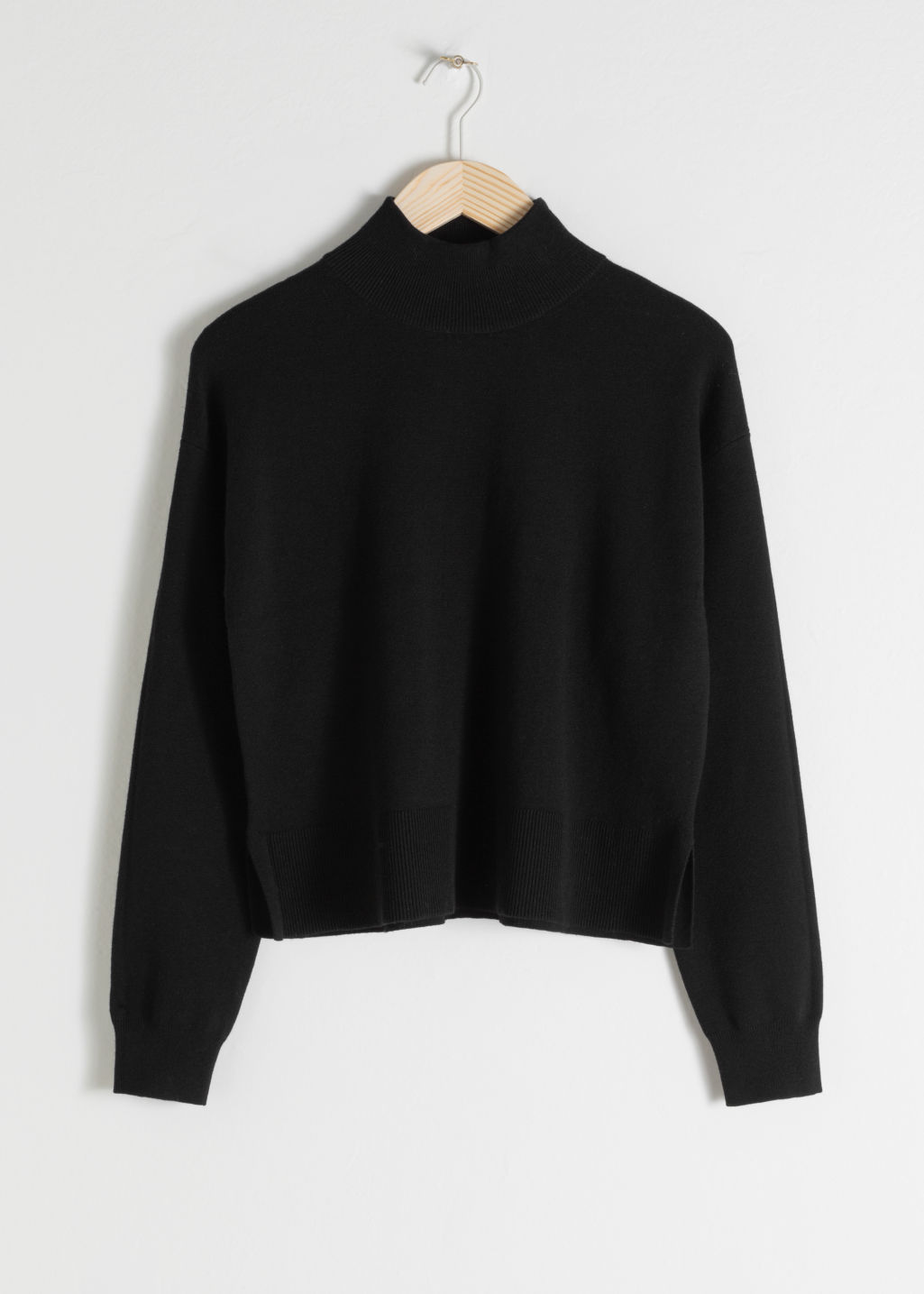 Front image of Stories wool blend mock neck sweater in black